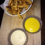 Fries with garlic aioli and dill mustard sauces