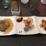 Trilogie de foie gras Filet de veau basse température Dis de Cabillaud sur lit de légumes de sai