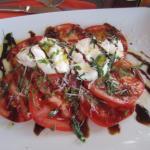 Caprese Salad with Burrata Mozzerella (mozzerella that is still soft inside) Delicious!