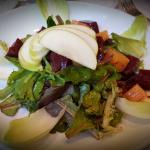 Beet and fresh apple salad on top of arugula ~ devine!