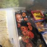 Messy salad bar with bad tomato parts.