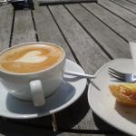 Flat white and tart in the sunshine.