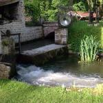 Water from water wheel under mill house