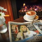 Coffee n paper by the fire