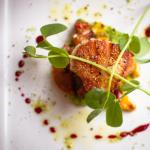 Pan-seared Scallop with green pea puree, warm chorizo relish, beet gastrique, olive oil