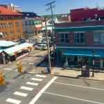 These two photos show an elevated street view of Sweet Teas, with one showing relationship to th