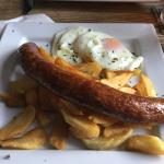 Cumberland sausage with egg and chips.