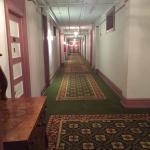 Long, spacious mauve/green hallway