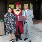 Graduate with Grand parents and view of Hotel