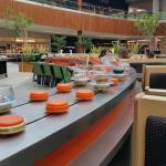 Conveyor belt sushi to slide right by your table...pick it up and mangia mangia!
