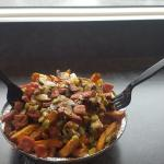 Smoked meat poutine with green peppers and mushrooms