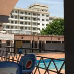 Pool area with a view of the back of Kwara Hotel