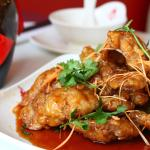 Deep fried crispy pork in Chinese sweet and sour sauce
