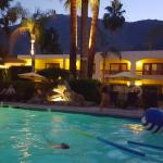 Twilight view of pool and mountians