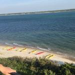 view of kayaks and beach from lighthouse