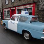 Police car and shops from Heartbeat