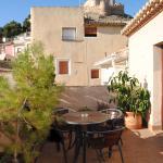 terraza del hotel en atico bellas vistas del castillo