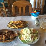 Chicken piri piri with a mountain of chips and salad.