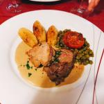Fillet steak of veal and beef, served with creamy sauce, roast potatoes and mixed vegetables