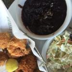 Shrimp with black beans and coleslaw.