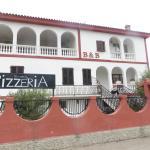 exterior - pizzeria on left side