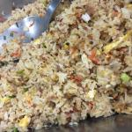 Healthy breakfast - brown fried rice with tuna , olive oil , fruits, eggs , fresh salad , honey