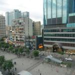View from the room - looking left - indoor market across the square