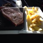 Lovely cut of steak presented on a hot stone so you can cook as you like. Nice chunky chips on t