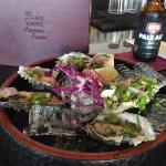 The oysters were local fanny bays and were good. They were mixed in a vinaigrette and chives, ni