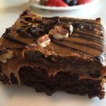 Dessert night included this decadent chocolate caramel brownie with pecans.
