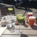 Delicious fresh green smoothies and coffee in the sun!