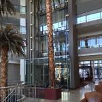 Main entrance atrium with glass-enclosed elevators.