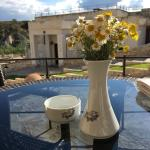 Outside seating area with fresh flowers
