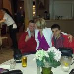 Kisses to the groom at rehearsal dinner