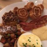 Breakfast Buffet: Mickey Waffles, Bacon, Grits, Eggs Benedict, Hash, Bread Pudding, and Sticky B