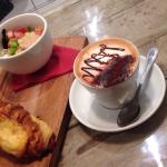 Ham and cheese croissant breakfast with a cappuccino
