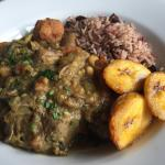 Curried goat served with rice and peas, dumpling and plantain.