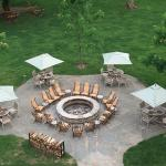Firepit and surrounding tables just outside the patio of Frontier Tavern.