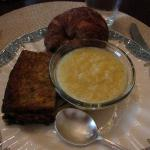 Breakfast frittata, grits, and croissant
