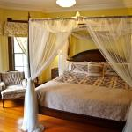 The Royal Suite features a four poster bed with king size pillow top mattress