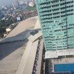 View from my room on the 28th floor: pool and roof of megamall...