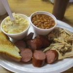 Two meat combo plate with potato salad and beans