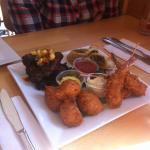 Fusion sampler: jerk wings, codfish fritters, coconut shrimp, vegetable rolls