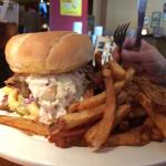 The pile sandwich. Bbq brisquet with Mac n cheese and Cole slaw on a bun