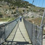 take a walk across the swinging bridge to get a view of the thermal pools from the river side