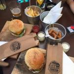 Burgers, fries with cheese and onion rings at Toster Bar