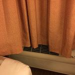 A/C blows up the drapes not into the room.