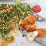 Skewered shrimp and salad