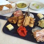 Antipasti board and delicious bread.