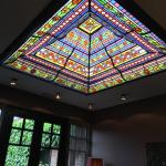 They found this beautiful glass ceiling window in a shop and replaced the original one by this o